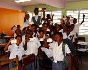 Students at Linden Foundation High School displaying their excitement for their new stamps