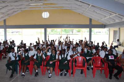 Students at West Demerara Secondary School proudly displaying their stamp packages